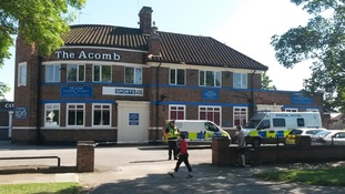 Police search The Acomb pub in York.