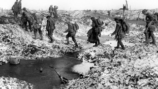 British soldiers negotiate the Winter landscape along the River Somme in late 1916 after the close of the Allied offensive.