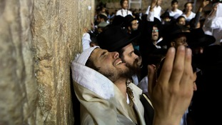 A Jewish worshipper takes part in a special prayer at the Western Wall in Jerusalem's Old City for the well-being of Israeli soldiers.