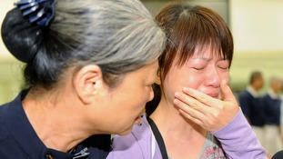 Relatives of a passenger on board the crashed TransAsia Airways plane cries.