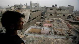 A Palestinian man surveys fresh damage in the northern Gaza strip.