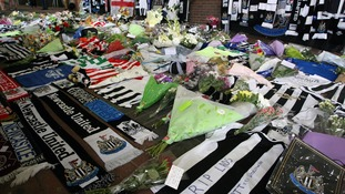 Tributes are placed for Newcastle fans John Alder and Liam Sweeney.
