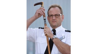 Assistant Chief Constable Ian Wiggett holding the cane gun.