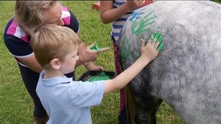 "Ollie Wilson, who is autistic, at ""Horses and Handprints"""