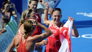 England's Jodie Stimpson celebrates winning the women's triathlon.