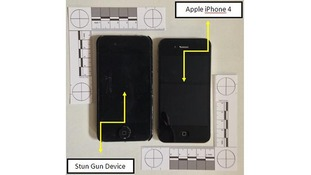 The stun gun, left, compared to an Apple iPhone 4.