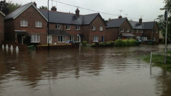 Houses in Angmering, West Sussex, surrounded by flood water.