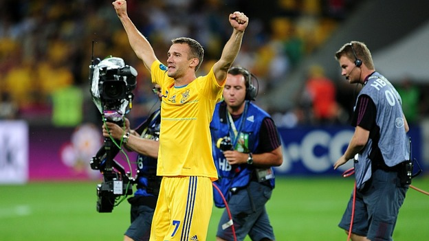Andriy Shevchenko takes the lion's share of attention at the final whistle as Ukraine beat Sweden.