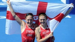 England's Jodie Stimpson (left) celebrates winning the women's triathlon with England's Vicky Holland who finished third