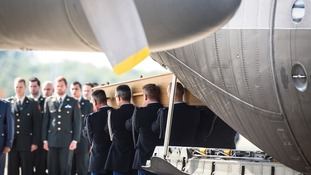 The coffins were carried from the plane during an official reception ceremony in the Netherlands after MH17 downed over rebel-held territory in eastern Ukraine.