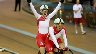 England's Sophie Thornhill and Helen Scott celebrate winning gold.