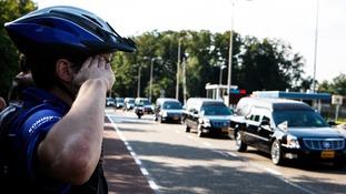 Policeman salutes