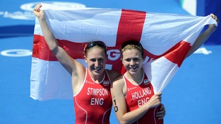Jodie Stimpson celebrates winning gold in the women's triathlon with England's Vicky Holland who finished third.