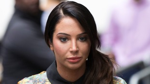 Former X Factor judge Tulisa will learn her fate over an alleged assault at last year's V Festival.