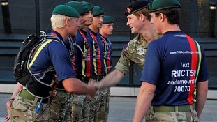 Captain Sam Moreton (26), 42 Commando from Exmouth introduces HRH Prince Harry to Mne Tom Barker (19) 45 Cdo, from Carlisle, Cumbria.