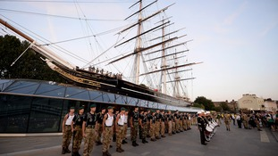 Royal Marines taking part in the 1664 Challenge form up in front of the Cutty Sark in Greenwich, London last night prior to the final leg of their gruelling journey.