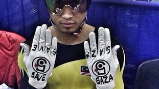 Malaysia's Azizulhasni Awang holds up his gloves to the camera.