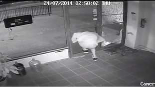CCTV footage captured the moment the clumsy criminal mistakenly headbutted the wrong glass door.