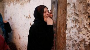 A Palestinian woman grieves during the funerals of four children from the same family.