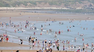 People enjoy the hot weather on the beach at Seaburn, Sunderland.