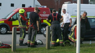 Fire fighters put on equipment before entering HMP Ranby.