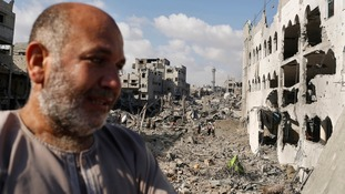 A Palestinian man cries as he looks at his destroyed house in Gaza.