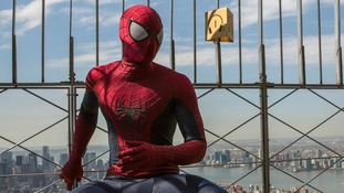 The man dressed as Spider-Man was arrested for demanding money from tourists.