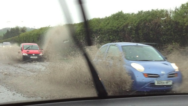 car splashing through water