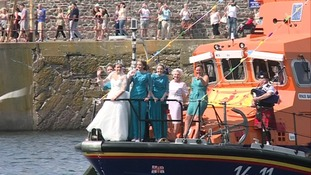 Thousands lined Eyemouth Harbour to welcome their new Queen