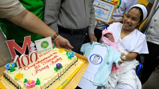 Chonalyn and her mother Dailin Duras Cabigayan were showered with cake and infant clothes after the historic birth in Manila.