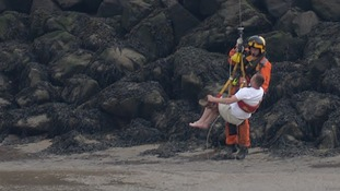A man being winched to safety