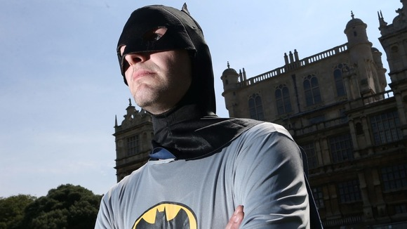 'Batman' says his aim is to save people from misery by putting a smile on their faces.