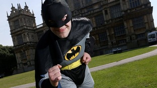 Batman is ready for action is front of Nottingham's Wollaton Hall.