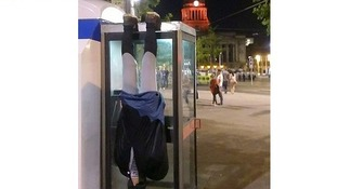 Here he is hanging from a phone box in Nottingham's Market Square.