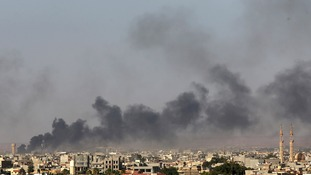 Militants and government forces clash in Benghazi.