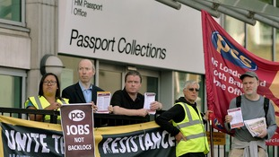 Workers outside the passport office in Victoria, central London go on strike over staff shortages.