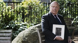 Lord Julian Fellowes with a picture of his great uncle Hamilton Stephenson.