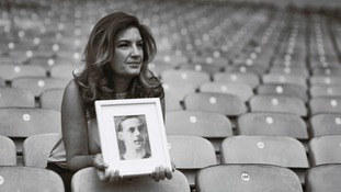 Karren Brady with a picture of Sgt Major Frank Cannon who played for West Ham.