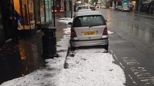 What looks like snow is left on the ground in Hove after a hailstorm.