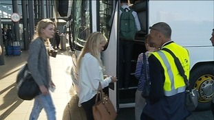 Passengers board a replacement bus