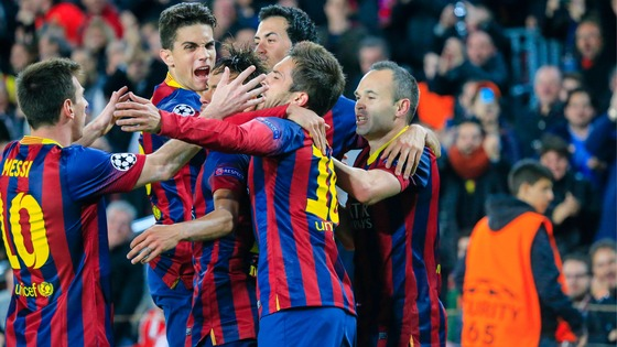 Barcelona players, including Messi, Neymar and Iniesta celebrating a goal