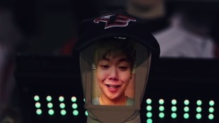 A fan uploads his face onto a robot at South Korea's Hanhwa Eagles stadium.