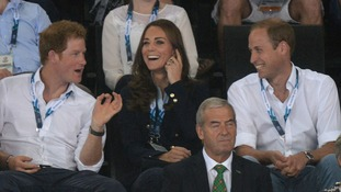 Prince Harry appears to make William and Kate lagch as they watch the action at the SSE Hydro.