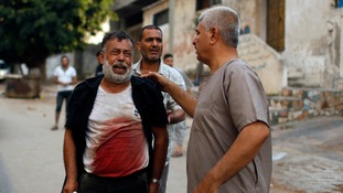 A Palestinian man cries after his son was killed during an explosion in Gaza.