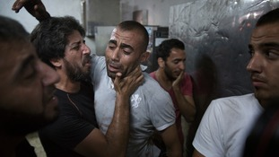 A Palestinian father at a hospital morgue in Gaza after his son was killed in an explosion.