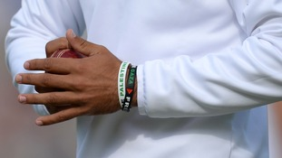 A close up view of wrist bands worn by England's Moeen Ali.