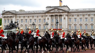 The Queen's Guards passing Buckingham Palace on horse back during the Trooping of the Colour