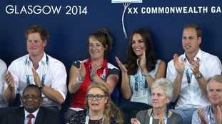 Prince Harry (left) watches a swimming session with The Duke and Duchess of Cambridge.