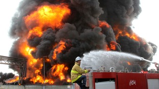 A Palestinian firefighter works during efforts to extinguish a blaze at Gaza's main power plant.