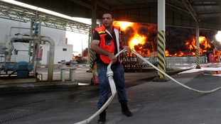 A Palestinian firefighter tries to deal with the situation at the Gaza Strip's main power plant.